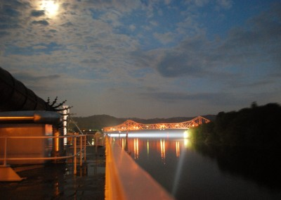 Low bridge ahead at night under a full moon.   *  Photo: Ted Scull