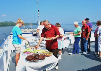 Lunchtime BBQ on deck.  *  Photo: Ted Scull