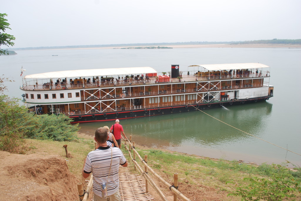 Boarding the boat on the Mekong River, Cambodia. * Photo: Ted Scull