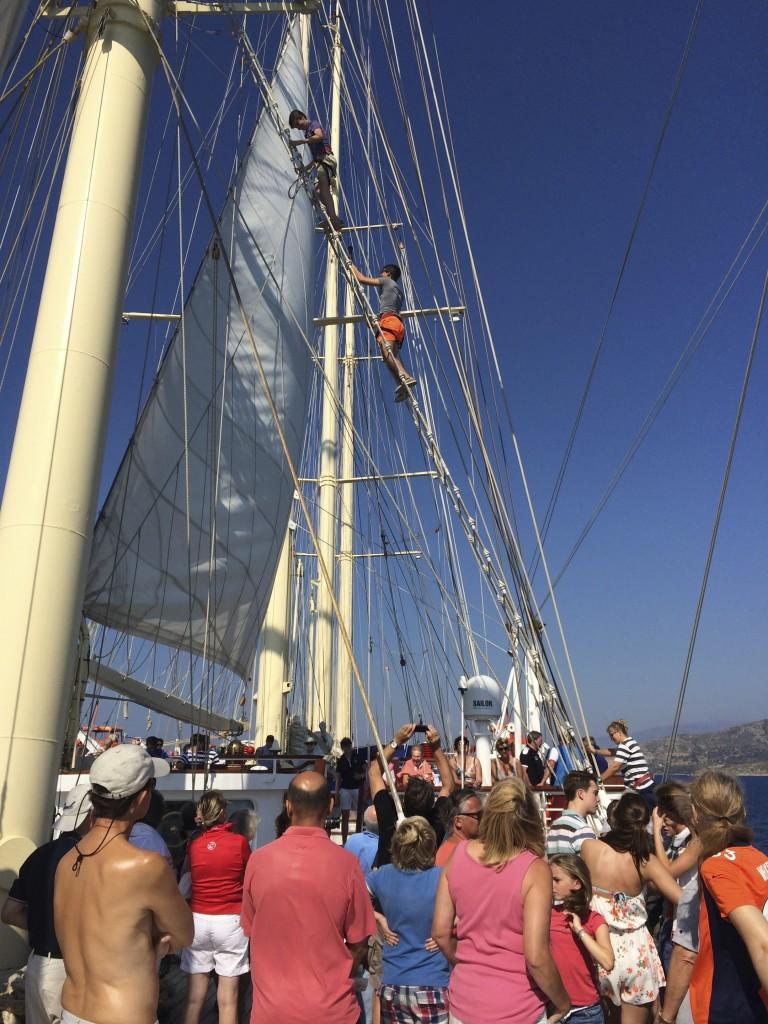 Climbing the masts is an event. Photo © Heidi Sarna