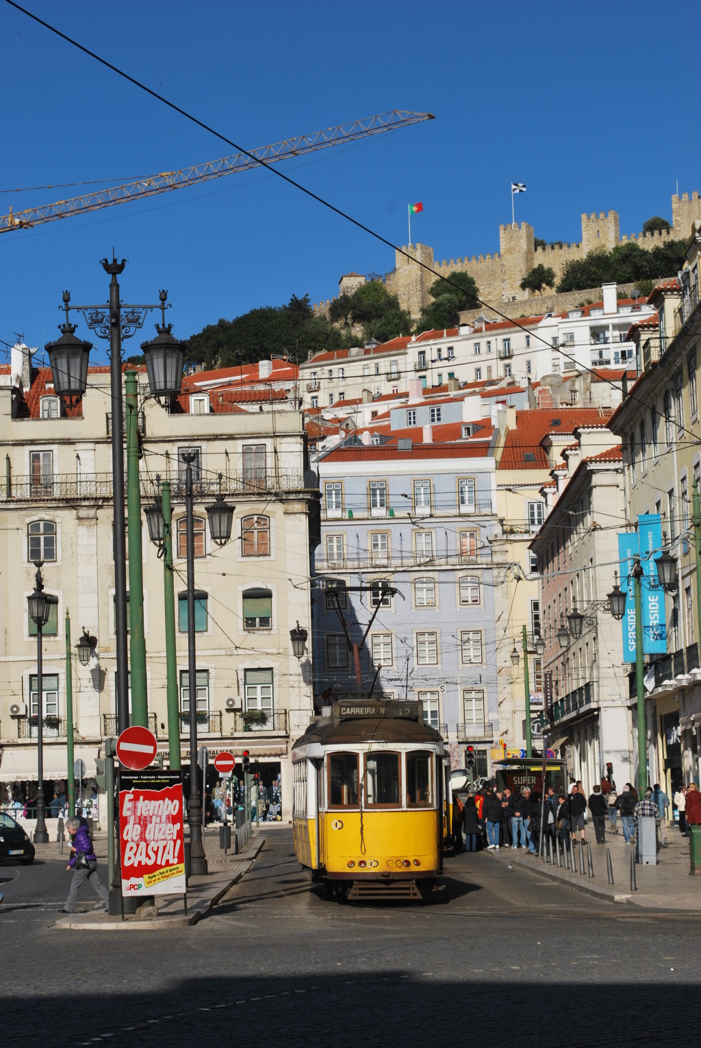 Lisbon's trams climb and descend hills across the city. * Photo: Ted Scull