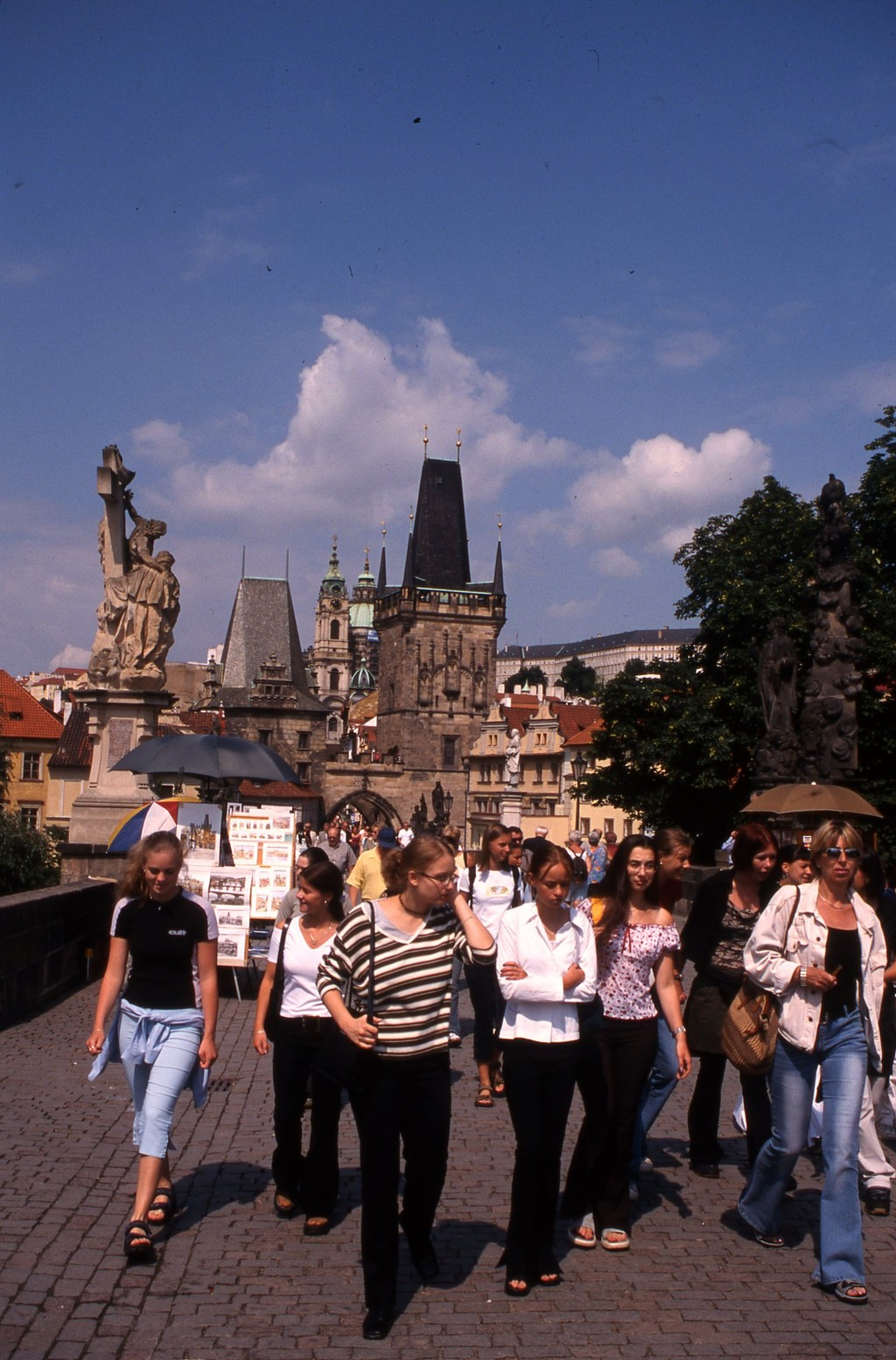 Walking the Charles Bridge, Prague. * Photo: Ted Scull