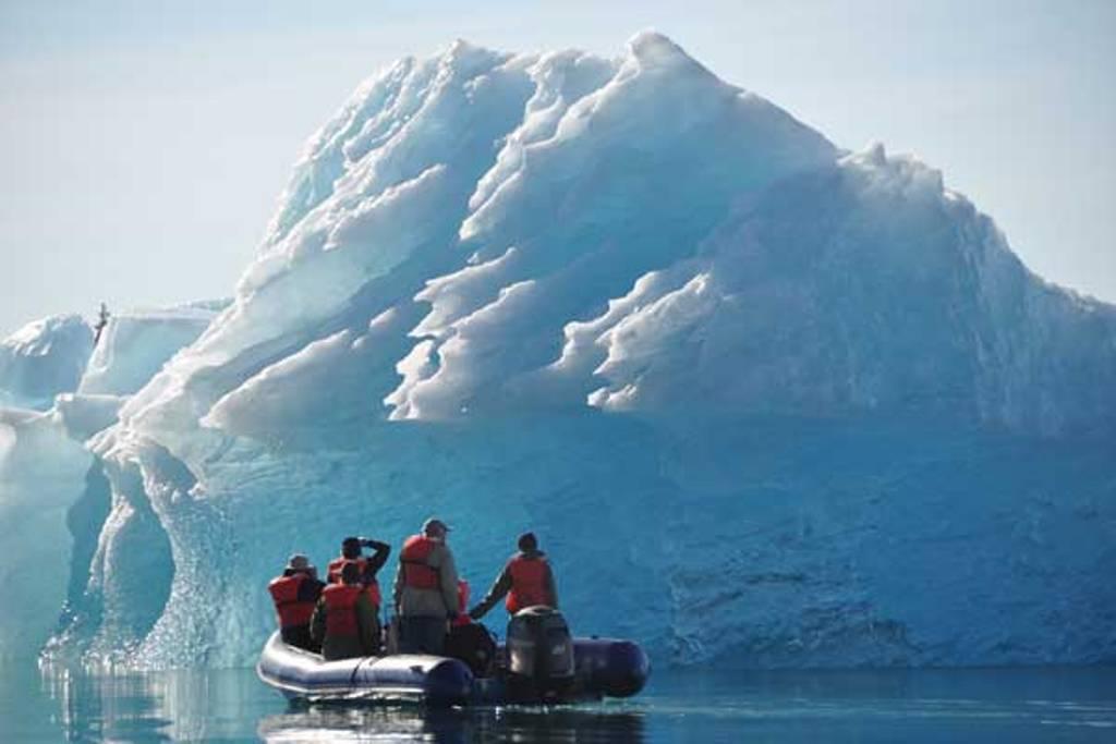 Alaskan ice by skiff. * Photo: Un-Cruise Adventures