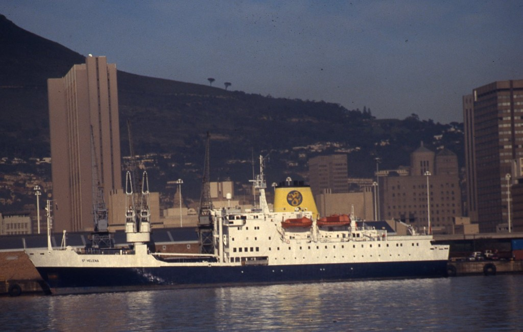 The RMS docked at Cape Town in the shadow of Table Mountain.* Ted Scull