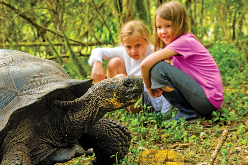 Children can get this close to a Galapagos Giant Tortoise, on Santa Cruz Island with Lindblad Expeditions. * Photo: Ralph Lee Hopkins