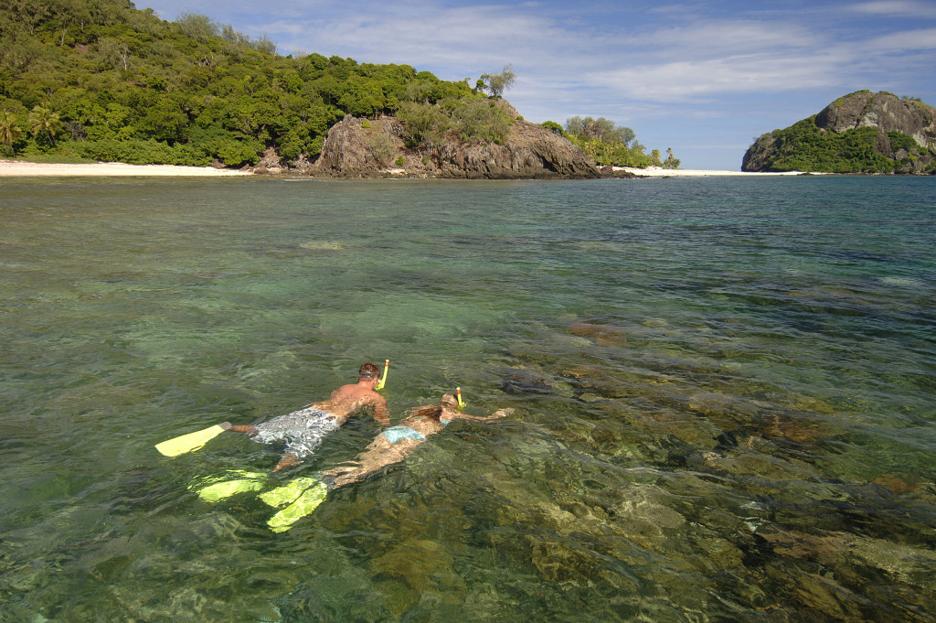 Snorkeling in the clear waters surrounding Fiji. * Photo: Captain Cook Cruises