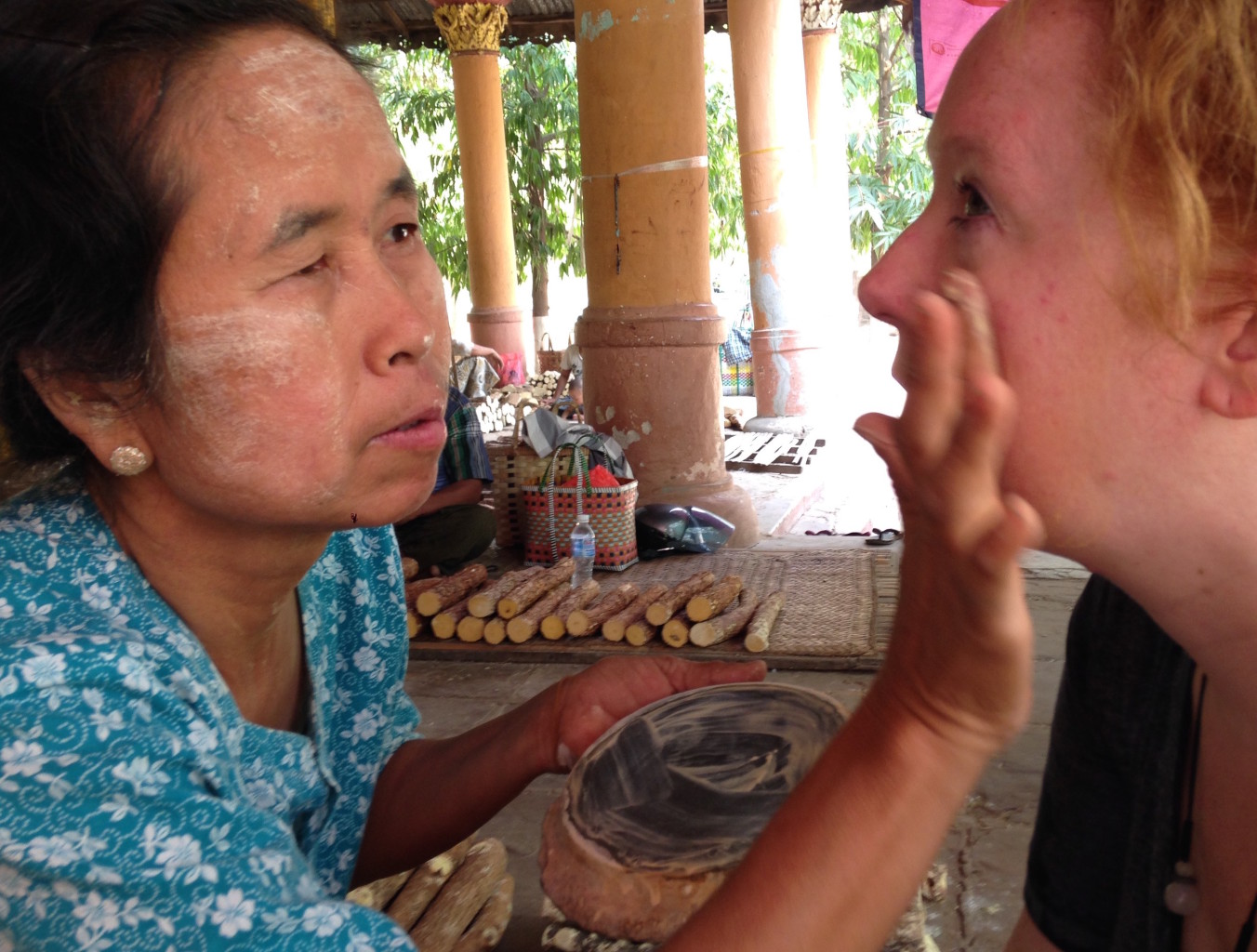 Local woman applying the traditional thanaka face paint still worn by many in Myanmar. * Photo: Heidi Sarna