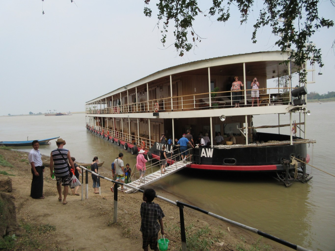 The trip to the ship. The Kalaw Pandaw tied up along the Irrawaddy. * Photo: Heidi Sarna