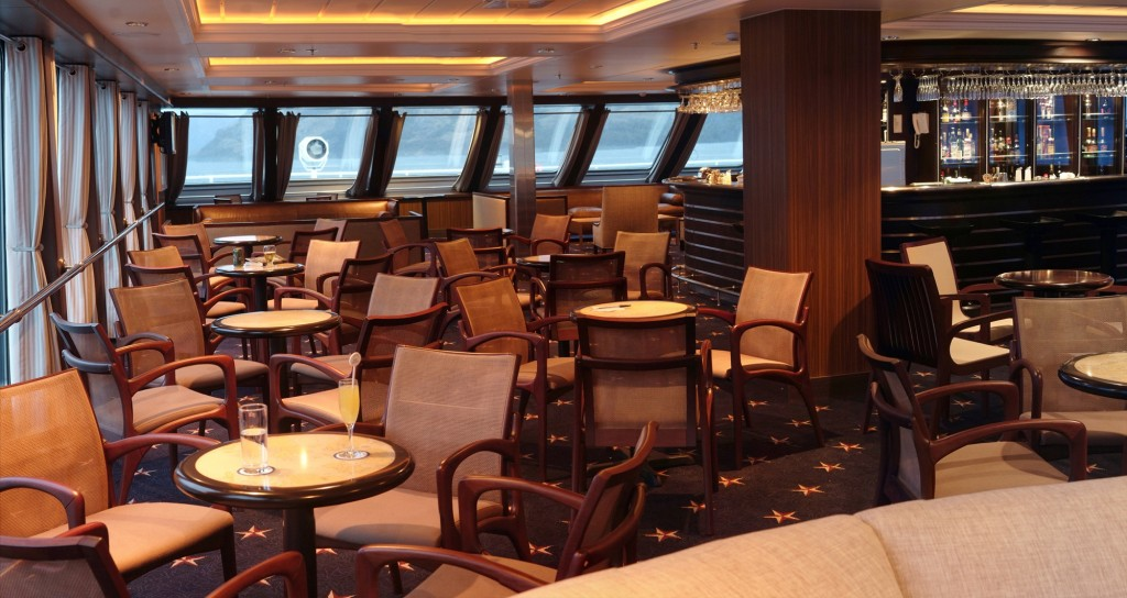 The Darwin Lounge is the ship's hub. * Photo: Australis