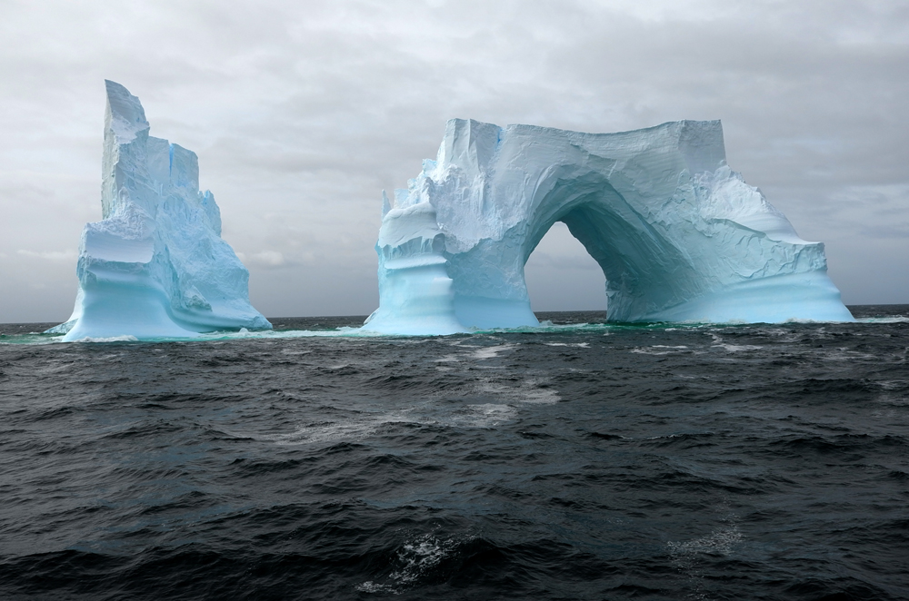 Iceberg arch off the west coast of the Antarctic Peninsula. * Photo: Richard White