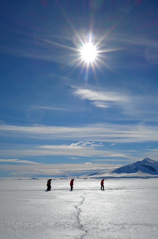 Hiking over shore-fast ice. * Photo: Richard White