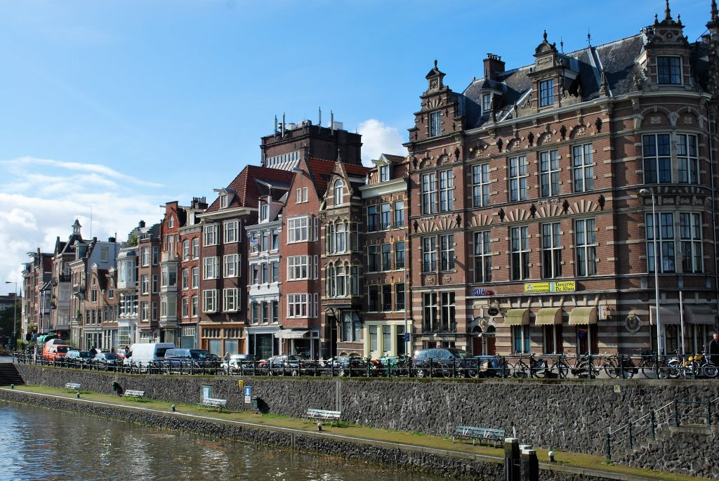 Handsome Residential and commercial landscaoes parallel miles of Amsterdam's canals. * Photo: Ted Scull