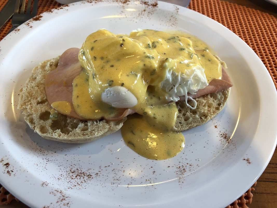 eggs benedict at breakfast on board cruise ship Vela