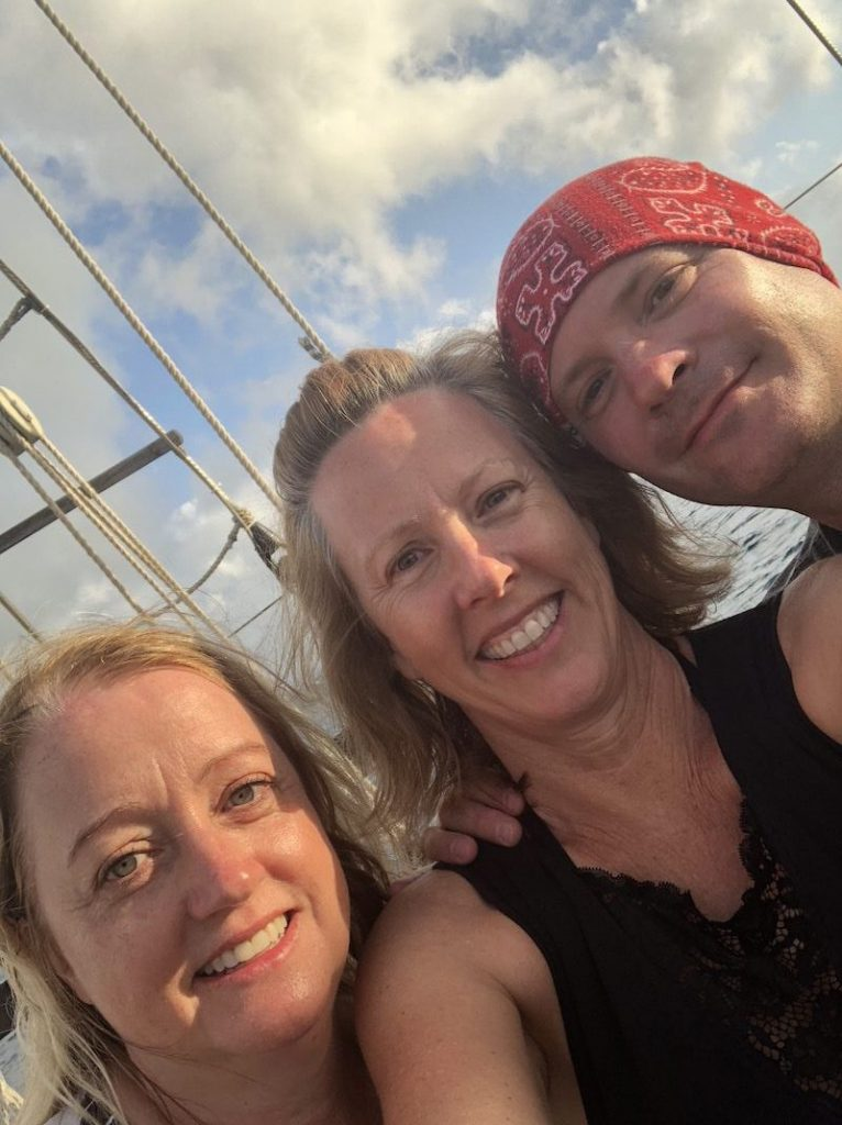 the author aboard the cruise ship deck with new friends