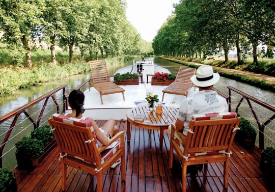 quirky-cruise-barge-lady-cruises-couple-drinking-wine-on-ship-deck