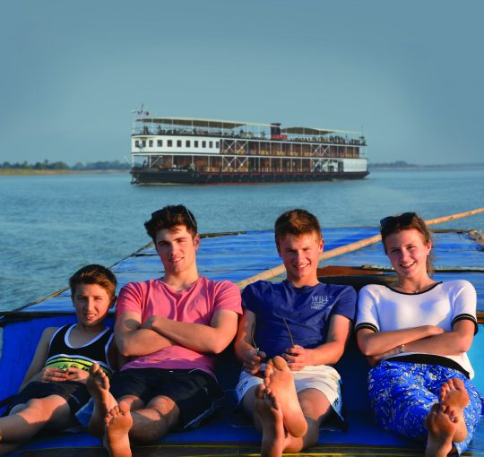 quirky-cruise-pandaw-family-cruise-deals-in-asia-family-sitting-on-boat