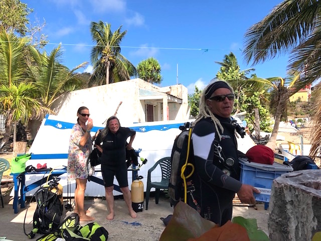 Island Windjammers' Caribbean Sailing Adventure stops in st lucia with people getting ready to dive