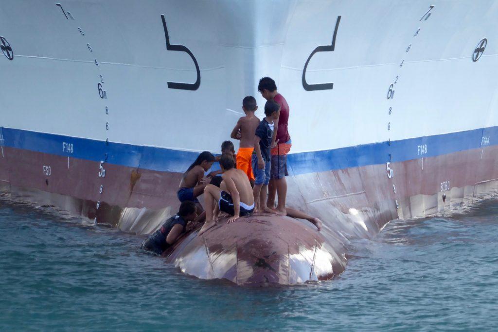 Kids on bow of Aranui 5