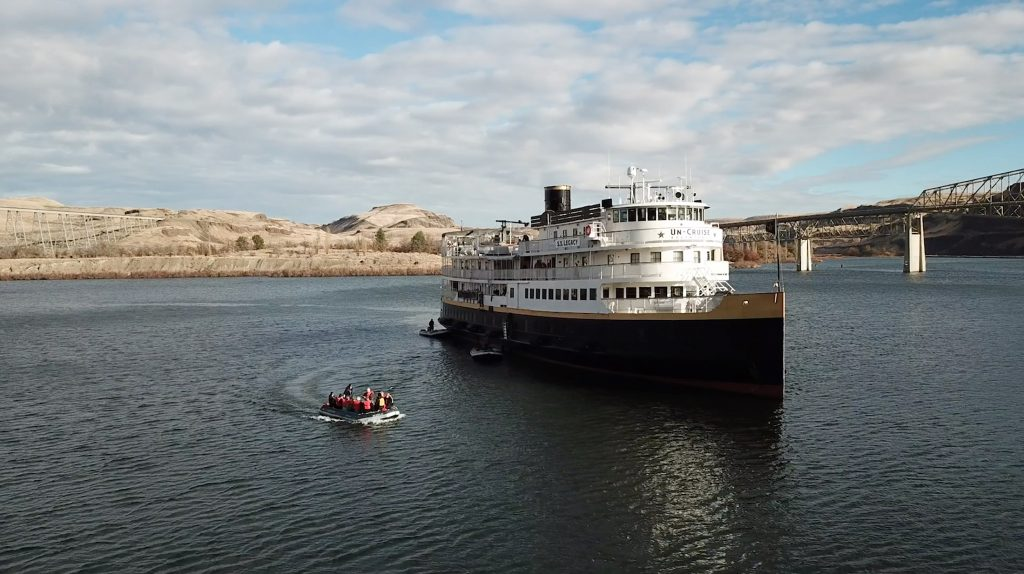 Guests moving to and from the SS Legacy by skiff on a Columbia & Snake Rivers cruise