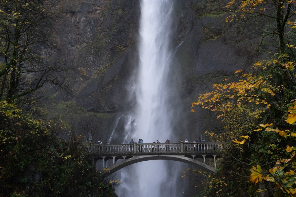 UnCruise guests on the Benson Bridge at Multnomah Falls on a Columbia & Snake Rivers cruise