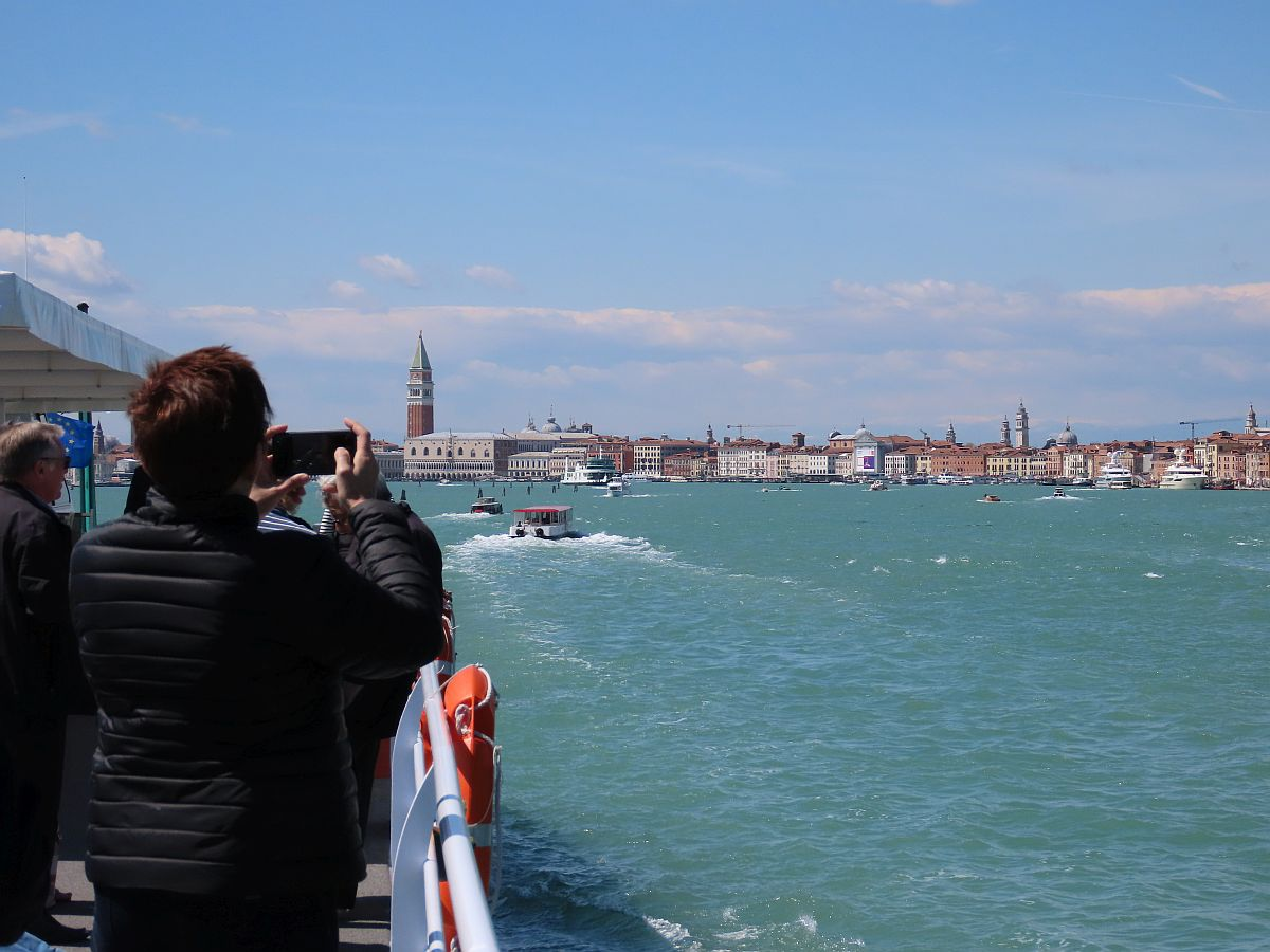 Taking in the sights from deck on the Venice & Its Lagoon itinerary