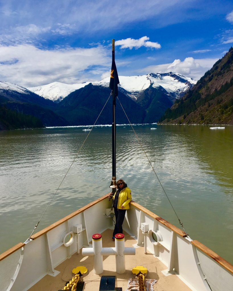 Alaska cruise with writer Judi Cohen on bow