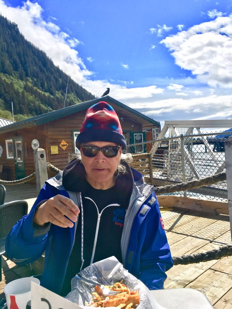 Lawrence Cohen enjoying our last Alaskan Fish and Chips on the dock in Juneau