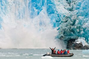 Guests get up close to a calving glacier in Southeast Alaska, at the Sawyer Glacier.