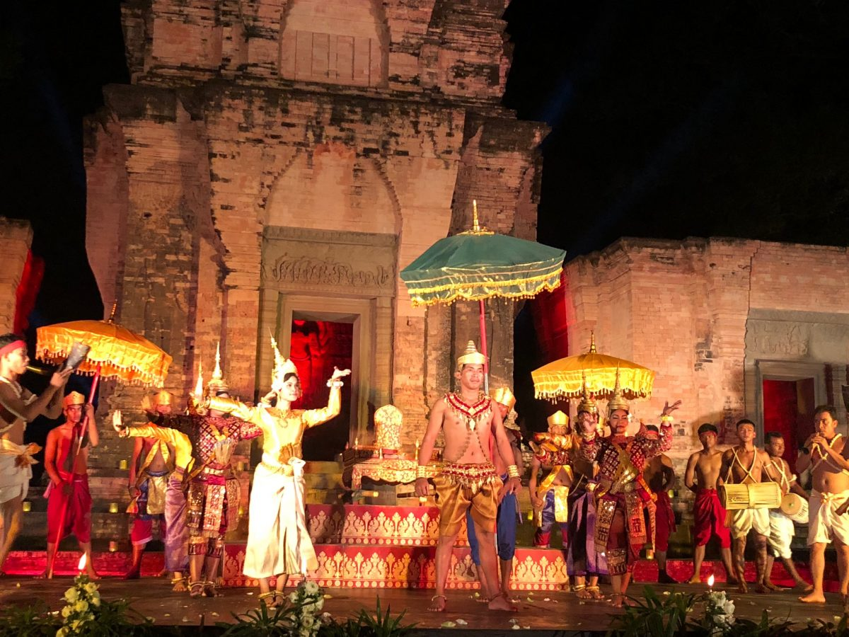 An Apsara dance performance in the shadows of a beautiful 10th-century temple.