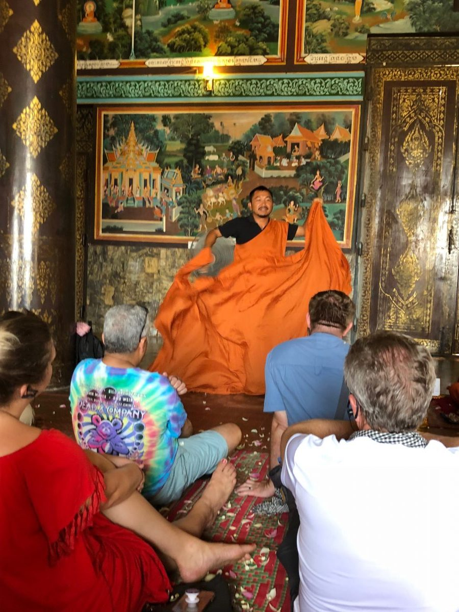 Scenic Spirit guide tying a monk robe