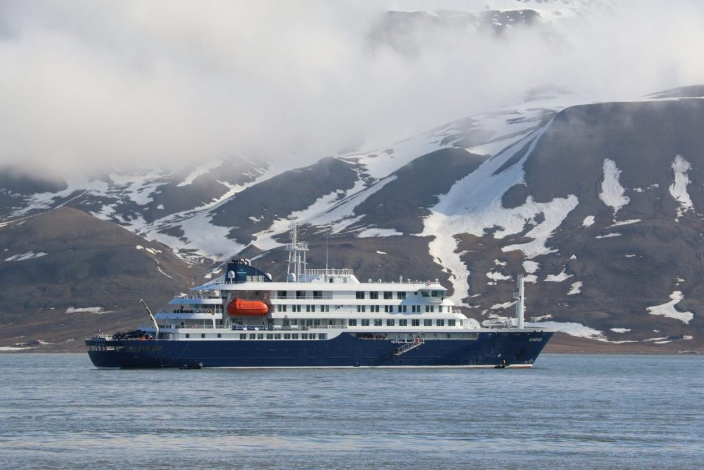 Hondius off Longyearbyn on its inaugural Arctic cruise