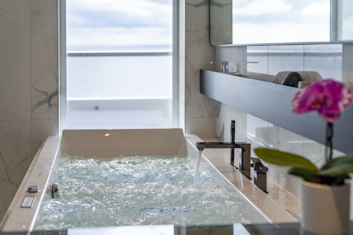 Ocean-view bathroom in a spa suite on Scenic Eclipse