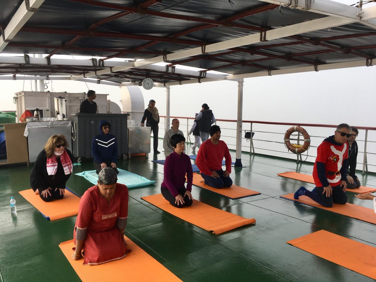 Yoga on top deck of ship