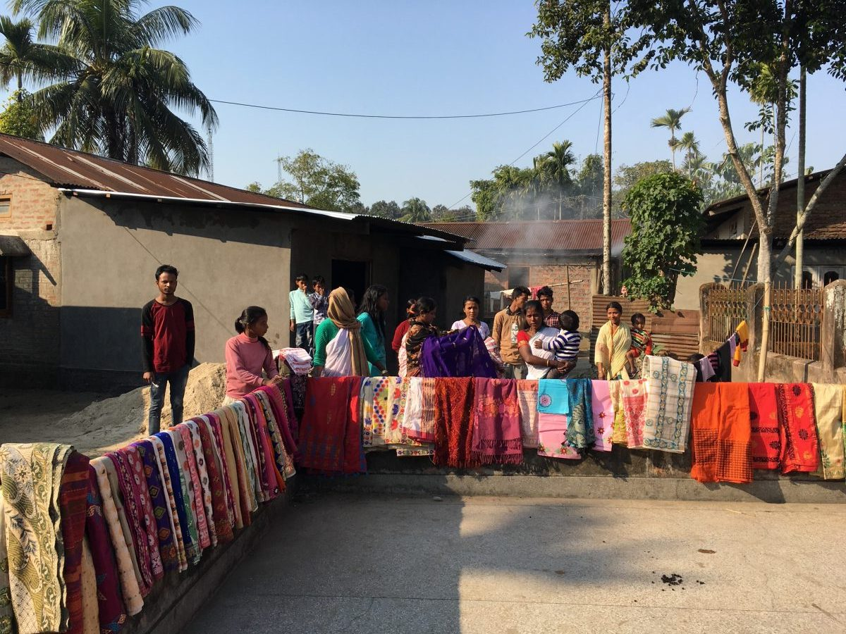 saress and textiles for sale in a village