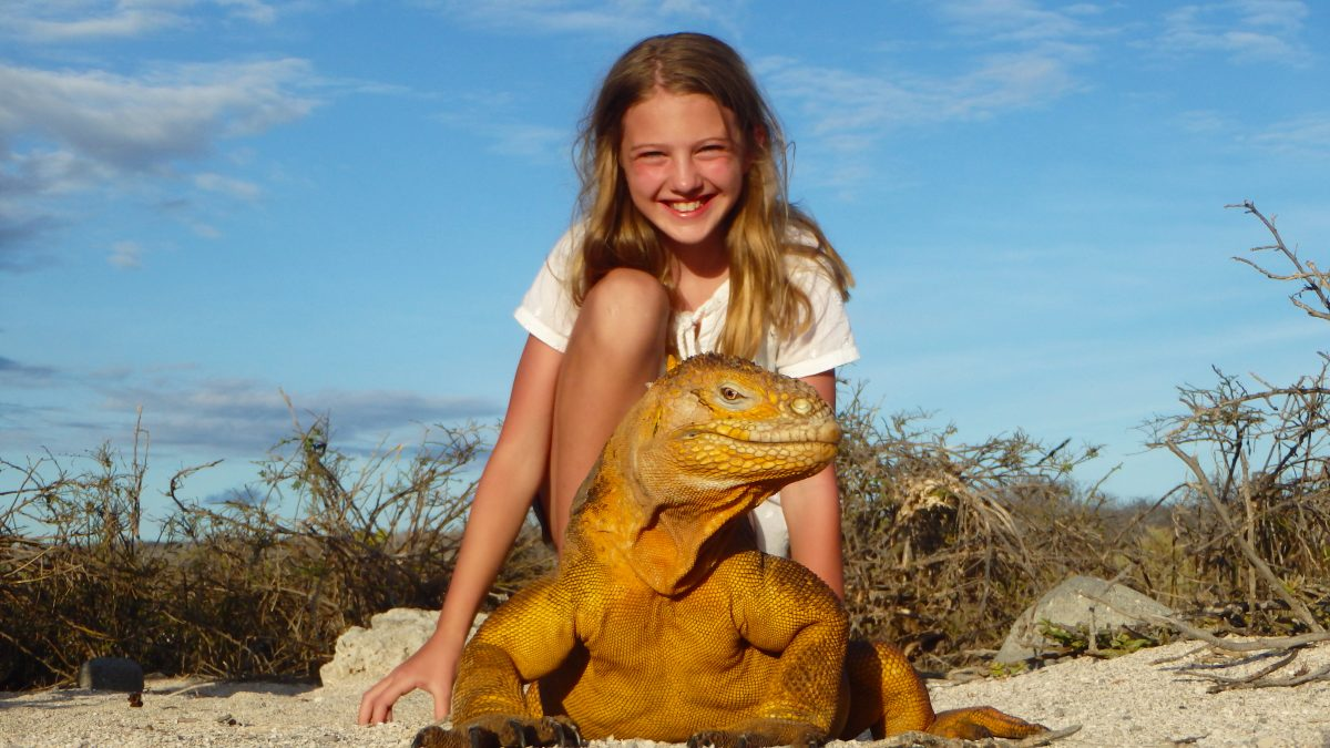Iguana and child in the Galapagos