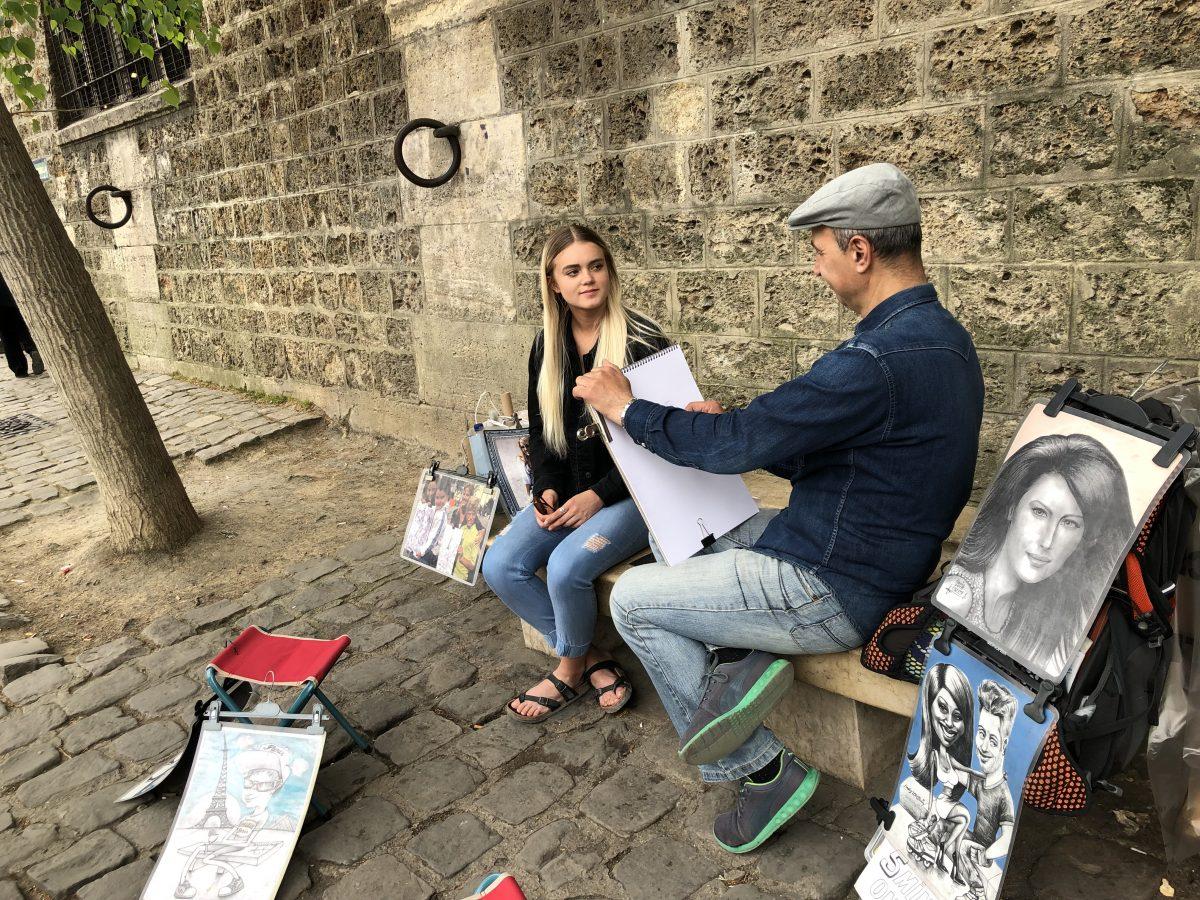 Artist portrait sketched outside of Notre Dame