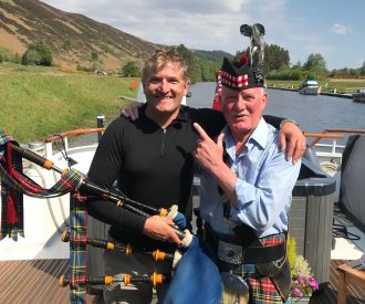 bag piper aboard the Spirit of Scotland