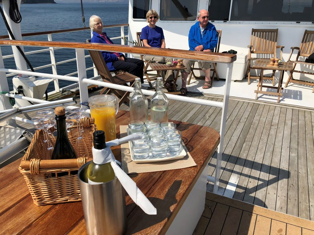 drinks on deck in the Hebrides