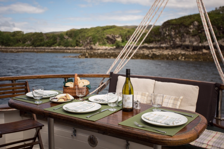 dining on deck in Scotland aboard the Red Moon
