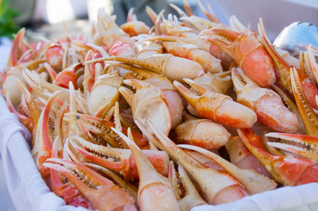 crab legs served at deck party